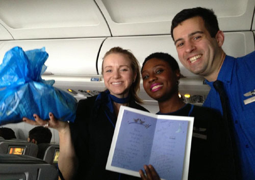 Crewmembers Virginia, Nickeloa and Daniel collecting goodies to give to the newlyweds