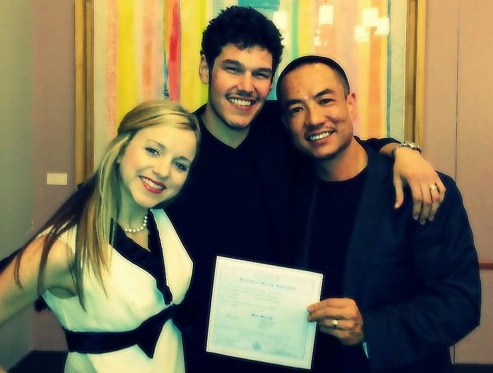 Inflight crewmember Virginia (left), with the happy couple showing off their marriage certificate
