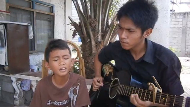 "(Watch) Viral: A Young Filipino boy Gives Amazing Acoustic Rendition of ""Dance With My Father"""