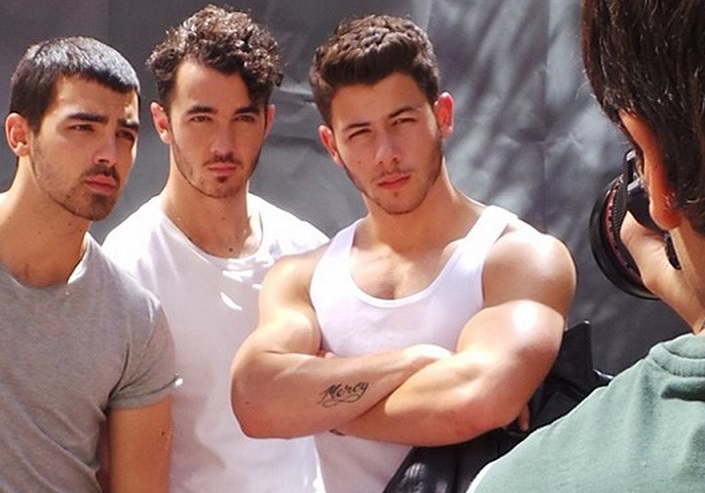 Nick Jonas Shows Off His Guns For Out Magazine Photo Shoot (Viral)