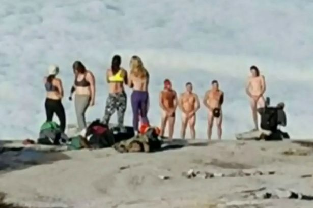 PAY-Tourists-strip-naked-before-taking-pictures-on-a-mountain-peak