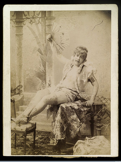 L0035132 PP/KEB/E/6/4, Man seated, wearing ladies shoes and stockingsCredit: Wellcome Library, London. Wellcome Imagesimages@wellcome.ac.ukhttp://wellcomeimages.orgMan seated, wearing ladies shoes and stockings, ruffle or lace edged open top (bare chested) and shorts or skirt, holding up an open fan. He is seated on a table with his feet resting on a stool.Richard von Krafft-Ebing (1840-1902), professor of psychiatry at Graz and Vienna, and pioneer of the systematic study of sexual deviation.PhotographLate 19th century Krafft-Ebing, Professor Richard Freiherr von Photographs, n.d.; 1896Published: - Copyrighted work available under Creative Commons Attribution only licence CC BY 4.0 http://creativecommons.org/licenses/by/4.0/